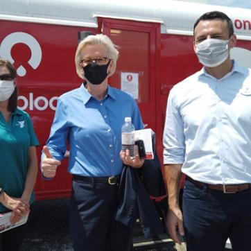 Tampa mayor Jane Castor with Tampa Y CEO Matt Mitchell and VP Marketing Jennifer Wainman in front of OneBlood bus