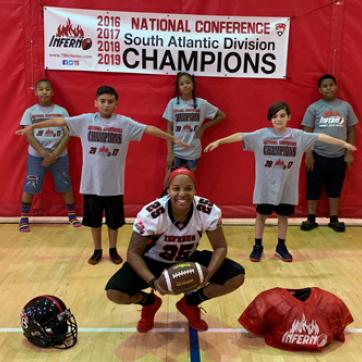 Tampa Bay Inferno Wide Receiver Dominique Jacobs with Y kids